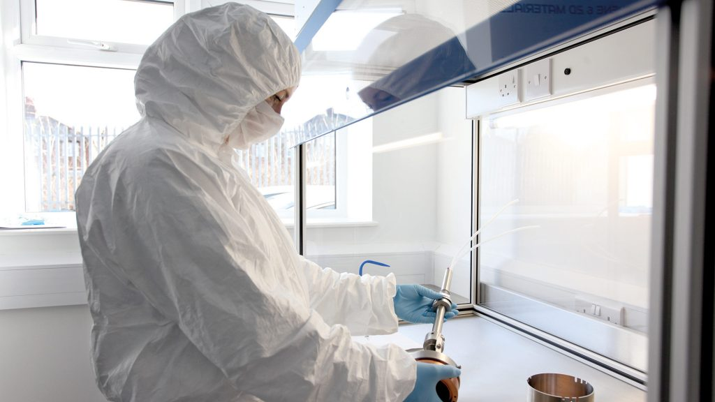 Photo of a person wearing a clean hood in a laboratory environment