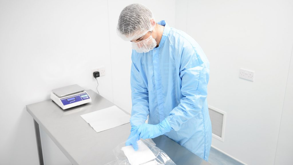 Photo of cleanroom operative working in a cleanroom