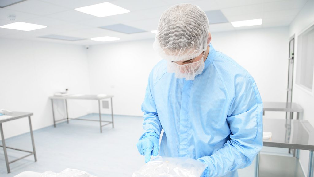 Photo of person wearing cleanroom PPE in a cleanroom