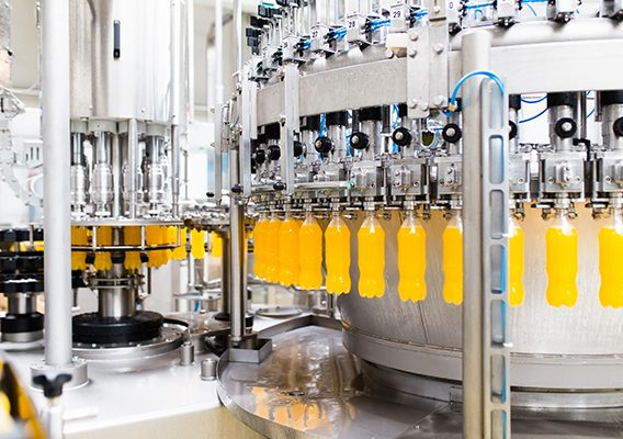 Water bottling line for processing and bottling orange carbonated juice into bottles.