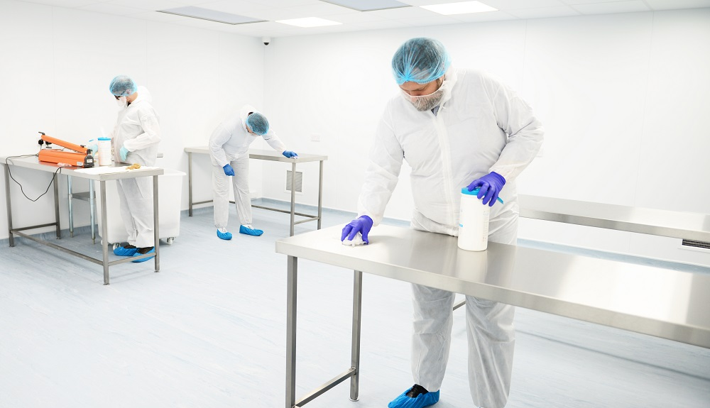 Photo of people working in a cleanroom environment